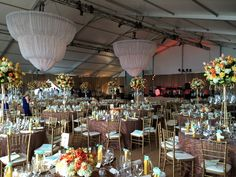 A combination of tall and low centerpieces give this tent lots of visual interest.