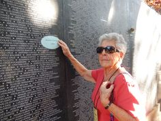 Mary finds Maura Clarke's name at the Monument to Truth and Memory in Parque Cuscatlan, a central San Salvadoran park.