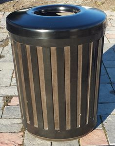 In recent years ribbed style metal trash cans have become very popular for use in streetscapefurnishings.  In an effort to offer our clients another alternative in keeping with this style we have createda solid concrete ribbed style trash can for your consideration. To look at this concrete version is difficult to discern from the metal version therefore will also blend nicely with any of the other metal site furnishings on the market today. All the while offering the economical but…