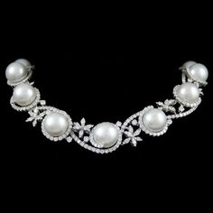 Pearl and Diamond Necklace  Pearl and Diamond Necklace set with Diamonds weighing 46.10 in 18 Karats in White Gold.