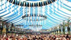 Oktoberfest tent - thinking this could be accomplished in any room with blue and white streamers!
