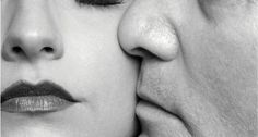 Image: Man kissing woman on cheek