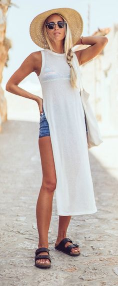 Why not breeze onto like Janni Deller in this long white shirt over denim shorts and a your favourite bikini top! Top: River Island, Shorts: Berska, Shoes: Birkenstock