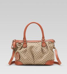 Gucci Sukey Bag Medium Coral, A Gucci favorite the Gucci Sukey handbag is in the winner circle every time. This medium sized handbag has double leather top handles with detachable leather shoulder strap. Crafted in traditional dia. New Handbags, Gucci Handbags, Handbags Online, Handbags On Sale, Online Bags, Gucci Bags Outlet, Chanel Online, Cheap Gucci, Discount Designer Handbags