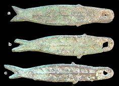 Three types of bronze fish money of the Zhou Dynasty, China.  circa 1122-255, BC.