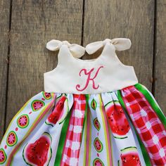 This dainty watermelon knot dress is monogrammed with the letter of your choosing! Makes a one of a kind coming home outfit, baby shower gift, or