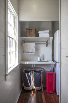 A laundry nook fits perfectly at the top of the staircase.