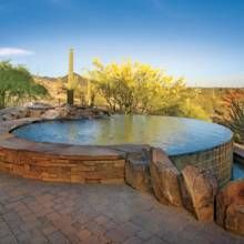 """This Western style watering hole is Surfaced in black Pebble Tec® and the saltwater pool and spa have a """"deep, rich, almost mysterious quality to them."""