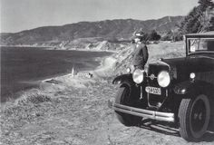 The Santa Monica Bay lighthouse from the edge of the Pacific Palisades bluffs (1931). The land on which the car and man are standing has since eroded, and fallen to the base of the cliff.