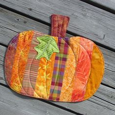Scrappy pumpkin quilt--could be used as a wall quilt, a table topper, or a place mat. by Toni Swedberg via Flickr.