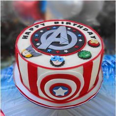 Avenger theme cake - My version of an Avenger cake picture that was sent to me. Design credit goes to person unknown but I thank them. I added the Captain America symbol in front. Cake is a tres leches layer cake. Big thanks to CC member sweettreat101 for her help. I could not have done this without her! Buttercream frosted with fondant Avenger's logo and hero faces. Third cake in an Avenger theme birthday party for 3 little 'superheroes'.