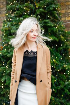 camel coat and lace top