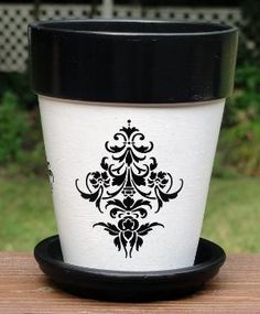 vinyl on flower pot, you can thank me later....wanna paint some pots yet