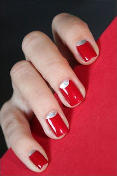 A red half moon nail polish was fashion in the late 30s and 40s, an early pin up style! This girl has made it modern by using a silver half moon, which looks really nice also for the holidays. I often use white or just no nail polish for the half moon.