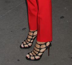 We love that Blake styled up her classic-feeling Michael Kors suit with a pair of sexier Christian Louboutin cage heels.