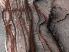 The north polar layered deposits of Mars, forming a layered stack of dusty ice up to 3 kilometres (2 miles) thick Picture: AP / NASA Surface of the Red Planet: images from NASA's Mars Reconnaissance Orbiter satellite