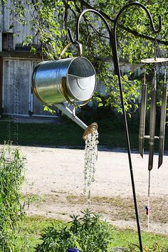 Old gardening tools often make excellent accent pieces, and a crystal shower watering can can light u your lawn with sparkling beauty.