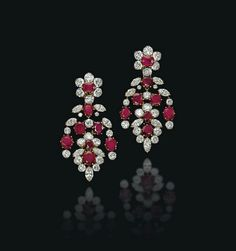 A pair of ruby and diamond chandelier design earrings, by M. Photo Christie's Image Ltd 2014 Of chandelier design, the oval and. Ruby Earrings, Ruby Jewelry, Ear Jewelry, Cluster Earrings, Stone Earrings, Gemstone Jewelry, Dangle Earrings, Minerals And Gemstones, Crystals And Gemstones