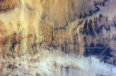 Windswept Valleys in Northern Africa: A photograph of windswept valleys in Northern Africa, taken from the International Space Station.