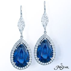 JB Star Sapphire and diamond earrings handcrafted with amazing 11.35 ctw pear shape blue sapphires edged with micro pave and hung from marquise diam...