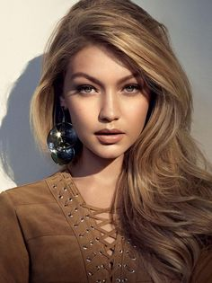 Wishing we had Gigi Hidad's honey blonde waves.
