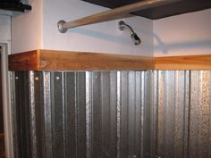 "How-to corrugated steel shower surround. (How about using a ""rainscreen"" system to hold the panels out from the wall ~1/2"" and waterproofing the wall behind?) Wouldn't it be cool to use bold color painted steel roofing panels for this application!"