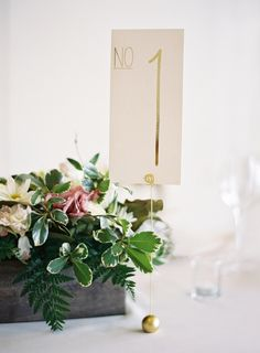 Gold table number that speaks volumes to your guests: http://www.stylemepretty.com/collection/2508/ Photography: Jose Villa - http://josevilla.com/