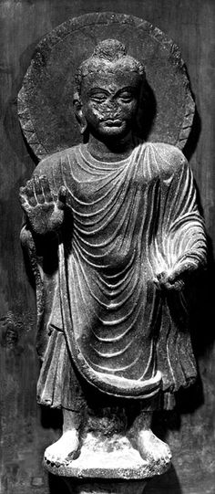"""Buddha, standing, in abhayamudra, with a lotus bouquet between his feet From Shotorak, Kapisa, Afghanistan grey schist H: ca. 24 1/2"""" Kabul Museum, Kabul Photograph taken in 1970"""
