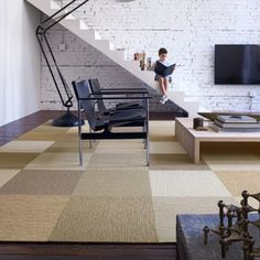 Flor carpet squares.  Cover up ugly carpet or make a custom rug.  Love the mix of neutrals.