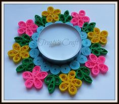 These beautiful multi purpose multi color tea light candle holder is made up of paper using Paper Quilling technique. You can use this cand...