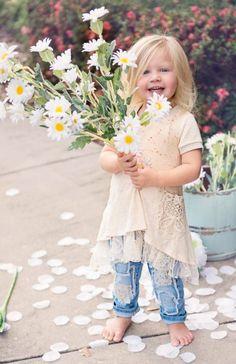 Precious little girl with her daisies.  #girls #children #cuties