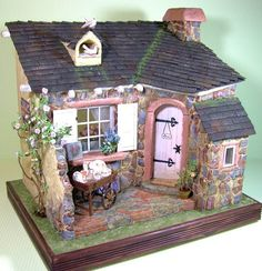 Rose Cottage miniature dollhouse. This is merely a picture, but great for ideas.
