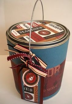 Father's Day gift idea ~ Decorate empty and cleaned paint can, line with tissue paper and fill with things dad likes.