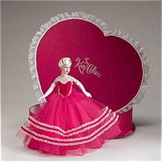 This Tonner Tiny Kitty Collier doll in a Valentine Heart Box is the best Tiny Kitty ever. There's not only the doll but a tiny bouquet of flowers inside. She is on sale for $155.00; use coupon code DKK1 for an additional 3 percent discount. She is our item no. KCT0015 at http://www.donnaskorner.com, our Tias.com/Collectoronline.com site. Robert Tonner does not use this stunning sculpt much any more.