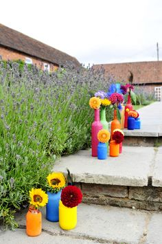 Coloured bottles of flowers