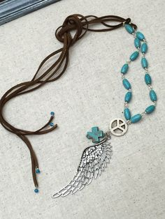 Angel wing necklace talisman Boho necklace by MarielaCorteJewels
