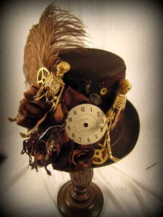 Steam hat. Feathered fancy.