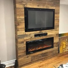 This fireplace has the perfect look featuring our brown barn board. Fireplace Feature Wall, Wood Fireplace Surrounds, Fireplace Tile Surround, Fireplace Tv Wall, Living Room With Fireplace, Fireplace Design, My Living Room, Porch Column Wraps, Barn Board Projects