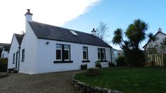 Tuathair Front Cottage - a stunning self catering property in the heart of Brodick, Arran. A beautifully renovated cottage. Sleeps 6. Pet Friendly. WiFi.