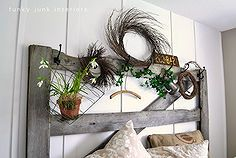 how to create your own headboard from junk, bedroom ideas, crafts, doors, home decor, repurposing upcycling, An old horse gate found on someone s burn pile is now my headboard with hooks changeable with every season Fun Visit post at