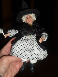 My beautiful witch doll by LISA FRANKLIN . Find her work on EBAY -and ETSY  mysticmoor Not only a friend but a talented artist that does mini bears-dollhouse dolls as well as bigger OOAK sculpture dolls-and Santas too! Thanks Lisa shes a treasure!