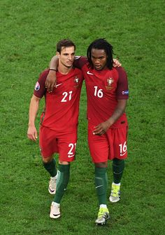 #EURO2016 Portugal's defender Cedric Soares and Portugal's midfielder Renato Sanches celebrate after winning the Euro 2016 quarterfinal football match between...