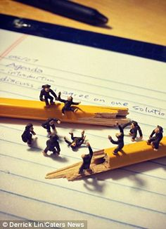 It's the little things in life: Miniature figures used to capture the everyday ups and downs of working in the office - Derrick Lin used figurines from model train sets to highlight office life - Mr Lin, from Columbus, Ohio, photographs the scenes with an iPhone - The scenes he created were photographed in an advertising agency