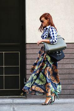 Print on print plaid shirt and full African print skirt