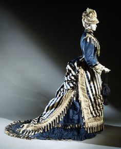 """1. Bustle Dress and Bonnet,"""" 1874 - Bustled with waterfall effect in back"""
