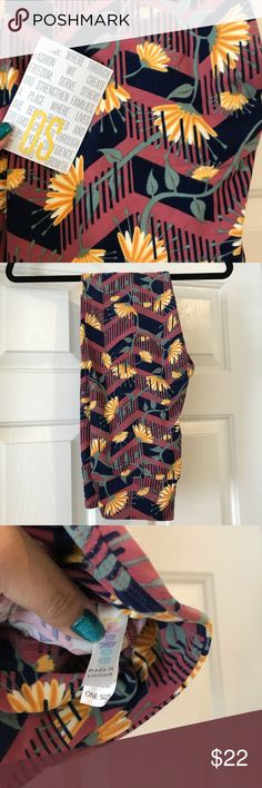 NWT OS Lularoe leggings mauve pink Brand new leggings. Famous super soft leggings. One Size fits sizes 2-10/12. Bundle and save. Mauve pink background with navy blue and gold yellow flower design. LuLaRoe Pants Leggings