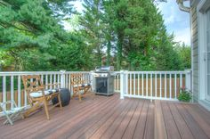 Bethesda, MD Deck - Deck using Fiberon decking - just beautiful.  Design and project done by The Sharper Cut Landscapes (sharpercut.com). Photo credit: Mark Petinga Photography