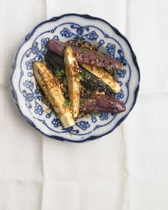 Sesame, ginger, soy sauce, and peanuts amp up the flavor of mild, custardy steamed eggplant.