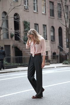 Love the tie-front blouse and the drapey look here, especially since she paired it with flat loafers.