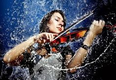 Rainy violin - I hope this is a cheap china factory violin, because those deserve to be ruined.  Cool pic
